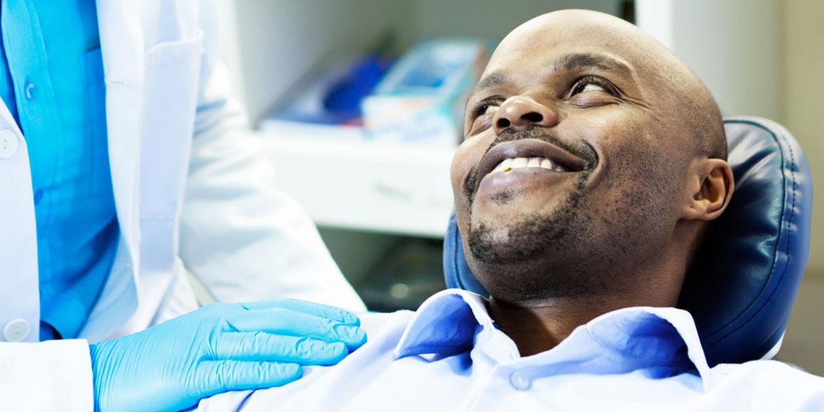 Restorative Dentistry - Smiling Man in Dental Chair